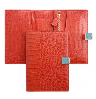 Smythson's hibiscus orange leather travel wallet