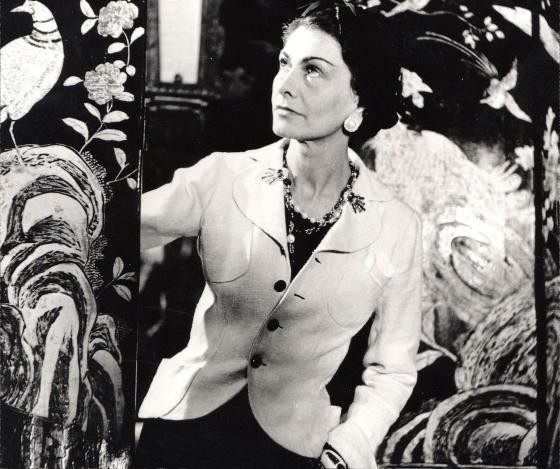 Coco Chanel in a trademark jacket