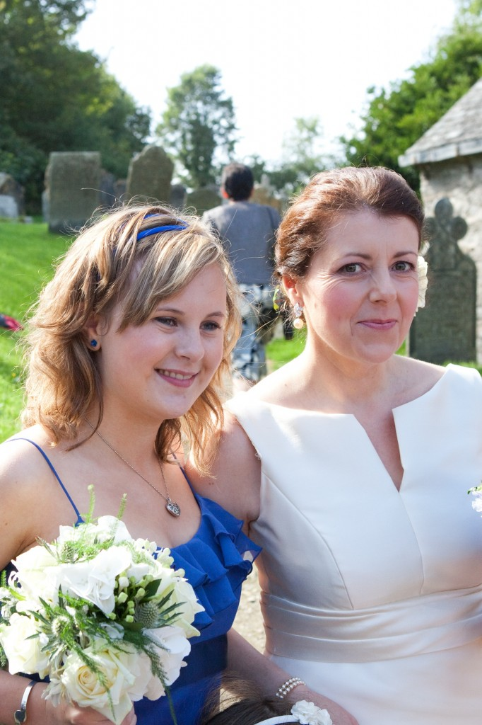 Bride and bridesmaid outside Lanteglos Church in Cornwall.