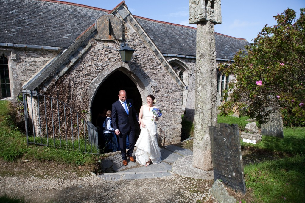 Bride and groom leaving Lanteglos Church in Cornwall.