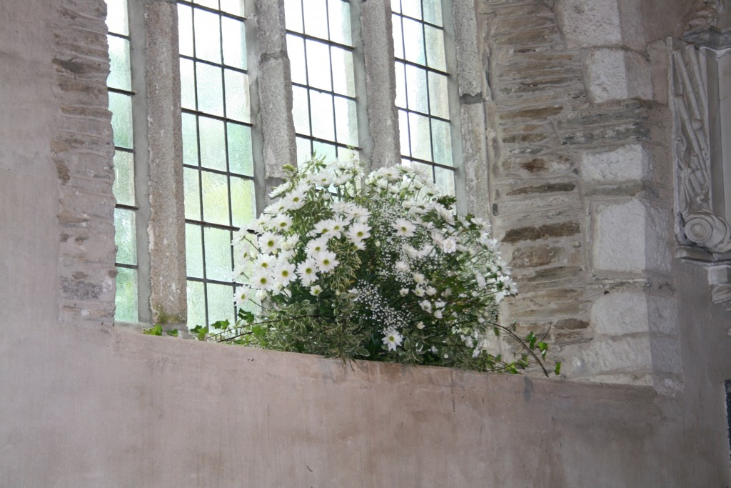 Ivory wedding flowers at Lanteglos Church in Cornwall.