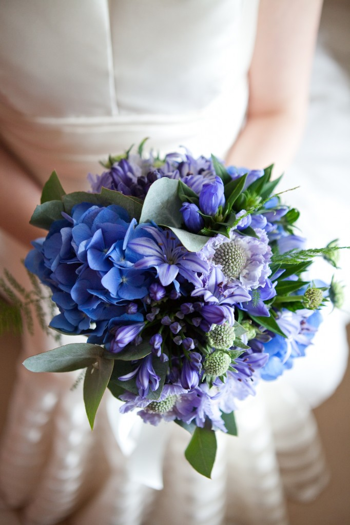 Brides wedding bouquet made of blue flowers.