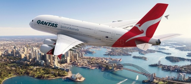 Qantas Airlines plane flying over Sydney